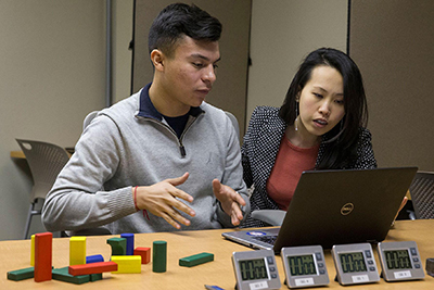 Student Hector Quijano with associate professor Eileen Cho